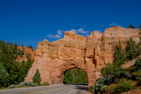 natural rock arch in road bryce canyon national park utah photo