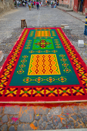 semana: detailed handmade easter carpets made from colored sawdust fruits and flowers in antigua guatemala