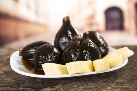 panela: Figs with honey and cheese on a plate ecuadorian traditional dessert Stock Photo