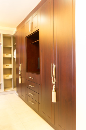 display of beautiful elegant wooden closet with built n space for television photo