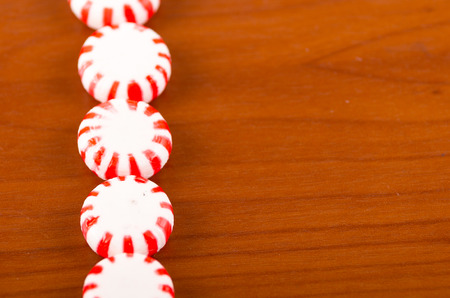 sweets candy caramel red striped peppermint closeup photo