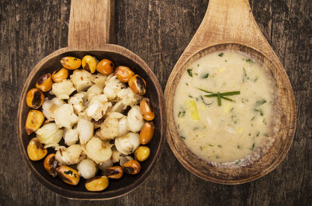 mote: hominy and toasted corn nuts mote with tostado an aji sauce on wooden spoons ecuadorian traditional food