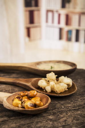 mote: hominy and toasted corn nuts mote with tostado an aji sauce on wooden spoons ecuadorian traditional food selective focus Stock Photo