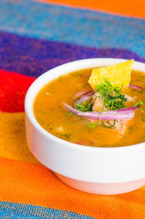 Delicious encebollado fish stew from Ecuador traditional food national dish closeup photo