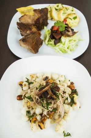 mote: mote tostado con chicharron and fritada hominy with toasted corn nuts and fried pork Ecuadorian food selective focus