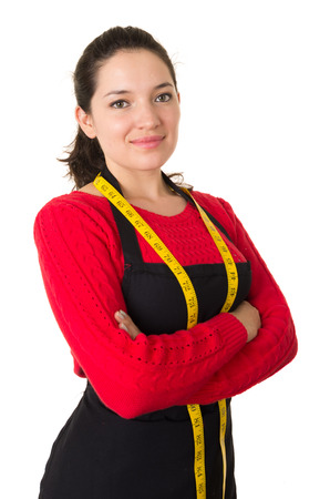beautiful young woman tailor seamstress designer stylist holding measuring tape crossing arms isolated on white