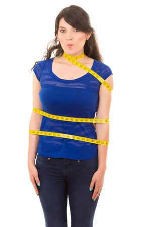 beautiful young thin girl with measuring tape around her body concept of dieting fitness weightloss isolated on white photo