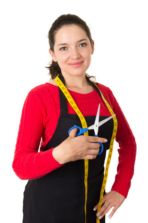 beautiful young woman tailor seamstress designer stylist holding scissors and measuring tape isolated on white Banco de Imagens