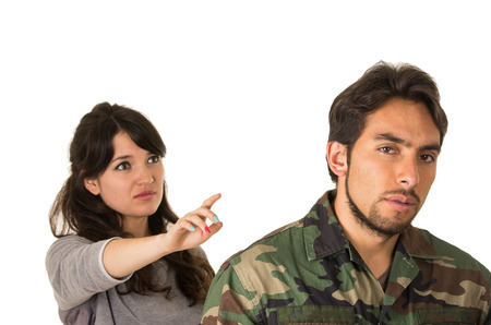 young woman and soldier in military uniform say goodbye deployment isolated on white
