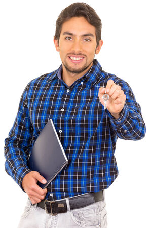 portrait of handsome man real estate agent holding a key isolated on white photo