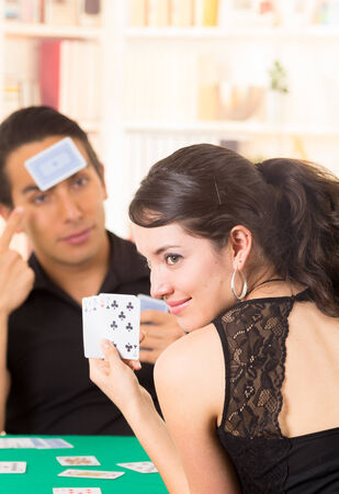 ecuadorian: young couple playing cards cuarenta traditional ecuadorian game Stock Photo
