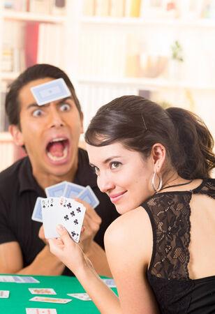 young couple playing cards cuarenta traditional ecuadorian game photo
