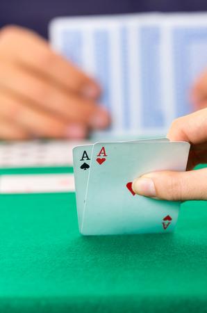 jack of diamonds: Playing cards closeup of hands lifting aces cuarenta traditional Ecuadorian game selctive focus