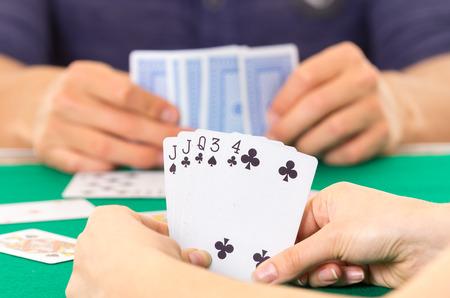 ecuadorian: Playing cards closeup of hands holding deck cuarenta traditional Ecuadorian game selective focus