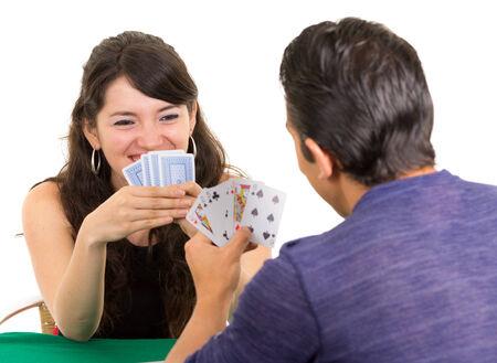 ecuadorian: young happy couple playing cards cuarenta traditional ecuadorian game isolated on white Stock Photo