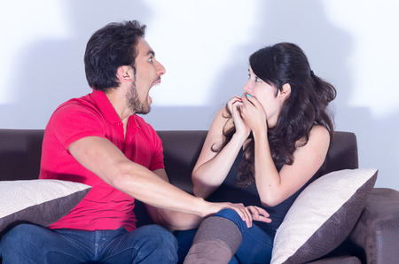 young attractive couple watching scary movie at home photo