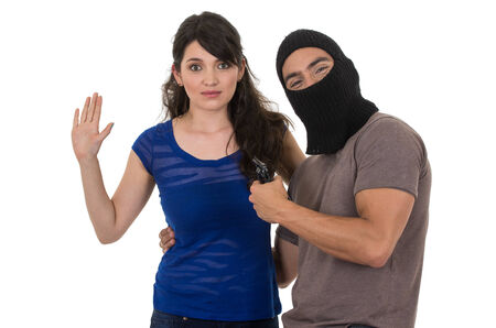 male thief with gun ready pointing at young girl with hands up isolated on white photo