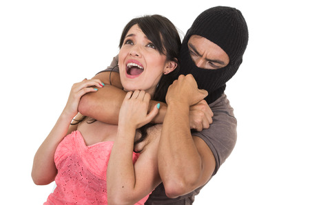 male thief holding strangling young scared girl isolated on white Stock Photo