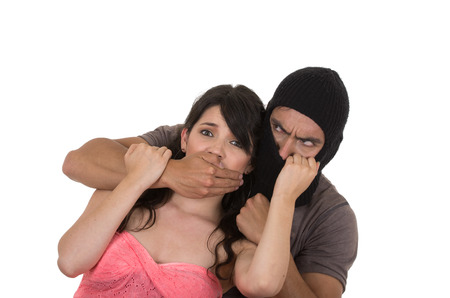 suffer: male angry masked thief holding silencing kidnapping young scared girl isolated on white Stock Photo