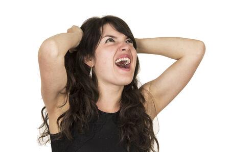 decepci�n: hermosa mujer morena con el pelo posando top negro sosteniendo con las manos que gesticulan decepci�n ira aislada en blanco