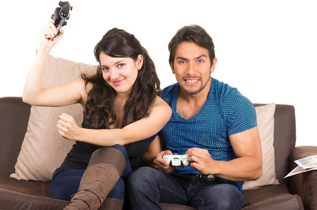young cute happy couple playing video games isolated on white photo