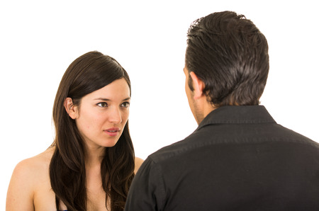 couple arguing: young unhappy woman having an argument with husband boyfriend isolated on white