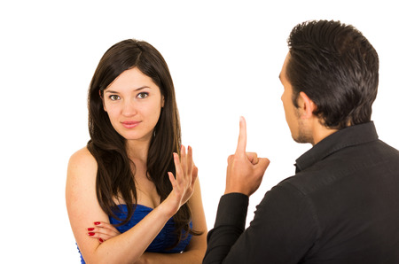 couple arguing: young unhappy woman ignoring husband boyfriend talking isolated on white