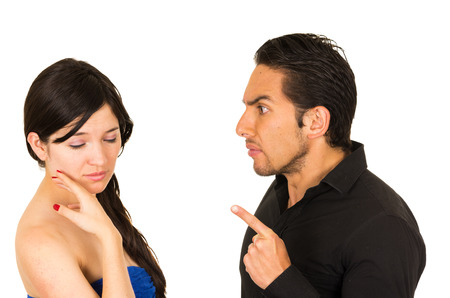 couple arguing: young unhappy woman having an argument with angry husband boyfriend isolated on white Stock Photo