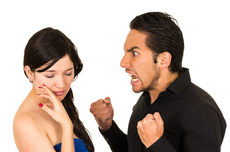 couple arguing: young unhappy angry man screaming at girlfriend wife isolated on white