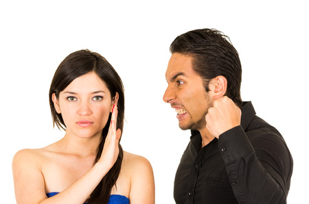 couple arguing: young unhappy woman not listening to angry screaming husband boyfriend isolated on white
