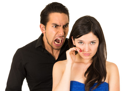 treason: young beautiful woman crying while husband boyfriend screams at her isolated on white Stock Photo