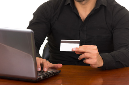personal shopper: happy young man buying online with credit card isolated on white