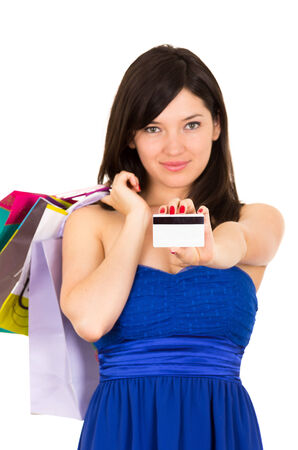 beautiful young brunette happy woman holding shopping bags and credit card isolated on white photo