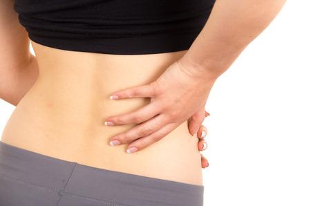 mujeres de espalda: mujer hermosa joven con dolor de espalda aislado en blanco Foto de archivo