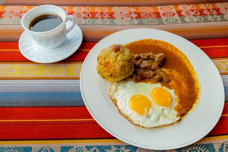 ecuadorian: Bolon de verde with fried eggs and meat stew ecuadorian food galapagos