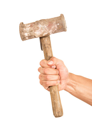 whack: closeup of hand holding a hammer isolated on white