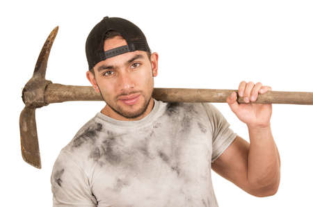 young muscular latin construction worker holding pickaxe isolated on white photo