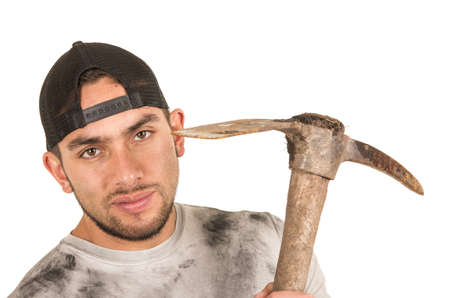 fixer: young muscular latin construction worker holding pickaxe isolated on white Stock Photo