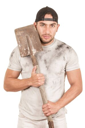fixer: young muscular latin construction worker holding shovel isolated on white