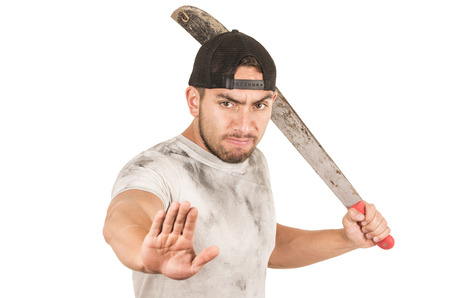 young muscular latin construction worker holding a machete isolated on white photo