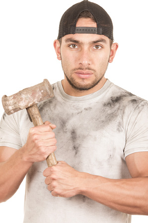 young muscular latin construction worker holding old hammer isolated on white photo