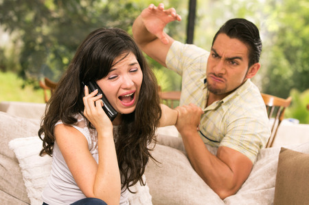 fight: married couple fighting having an argument at home wife calling for help concept of domestic violence