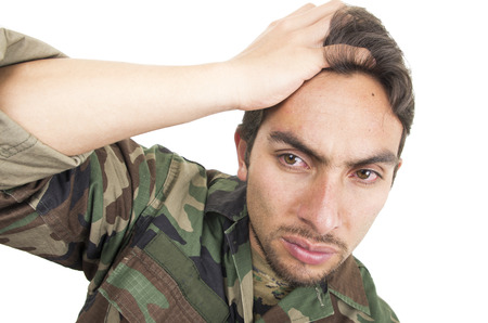 teary: distraught military soldier veteran ptsd with teary eyes isolated on white Stock Photo