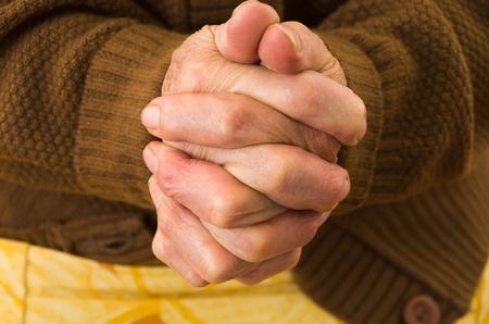 praying together: closeup shot of grandmothers hands praying together