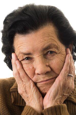 nostalgic: closeup portrait of grandmother looking nostalgic at camera Stock Photo