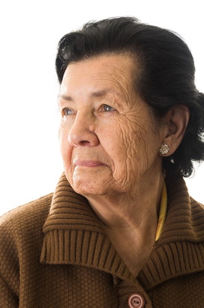 closeup portrait of grandmother looking to the side nostalgic