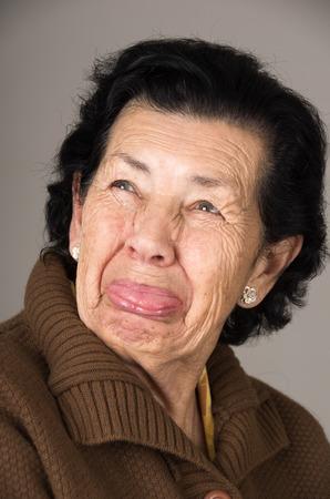 cranky: closeup portrait of old cranky grumpy sad woman grandmother