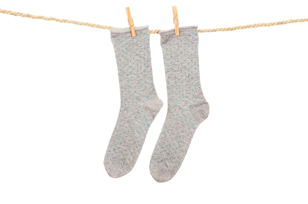 socks hanging on a rope clothesline isolated on white photo