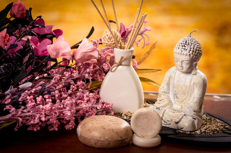candle light: incense soaps and buddha statue with pink flowers spa concept Stock Photo