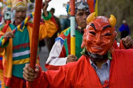elaborate: GUARANDA, ECUADOR - MAY 30, 2010: Unidentified masked dancer wearing an elaborate costume at Inti Raymi indigenous celebration in Guaranda, Ecuador